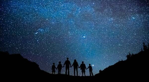 Family looking at stars at night